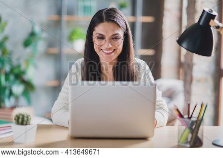 Photo Of Worker Lady Sit Desk Work Computer Look Screen Beaming Smile Wear Eyeglasses White Pullover