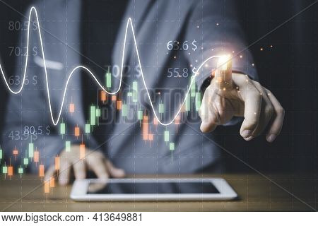 Businessman Touching Stock Market Technical Chart On Virtual Screen Of Tablet For Analysis Financial