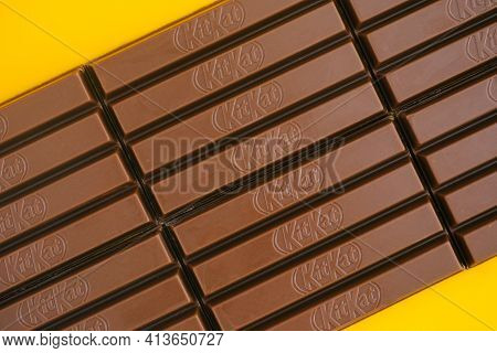 Tambov, Russian Federation - March 19, 2021 Row Of Kitkat Chocolate Bars On Yellow Background.