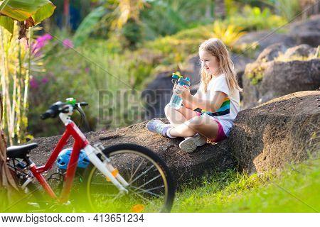 Kids On Bike In Park. Children Going To School Wearing Safe Bicycle Helmets. Little Girl Biking On S