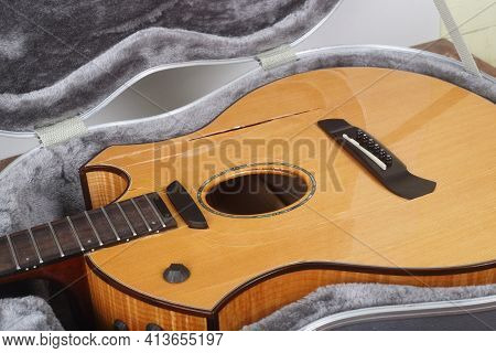 Musical Instrument - Closeup Fragment Broken Acoustic Guitar In Hard Case