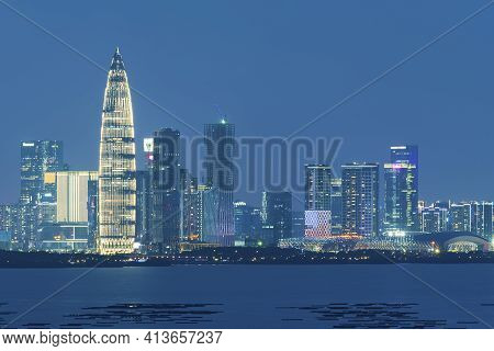 Skyline Of Shenzhen City, China At Night. Viewed From Hong Kong Border