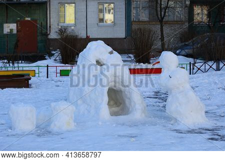 Snowman At The Snow Cave In The Courtyard Of A Residential Building