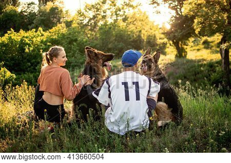 Pet Love, Dog Training, Best Dog Breeds For Family. Young Sports Couples Walking With Two German She
