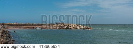 Swakopmund, Namibia - Jan 11, 2020: Public Beach With People Swimming In The Ocean At The Promenade