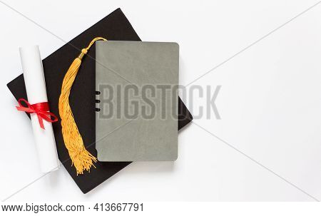 Graduation Top View Concept. Notebook, Academical Hat And Diploma. Copy Space
