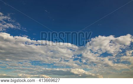 Dramatic Blue Sky With Rays And White Clouds