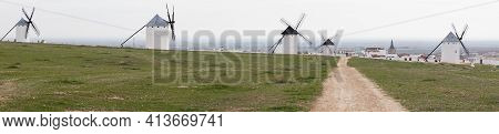 A Panorama View Of The Historic White Windmills Of La Mancha Above The Town Of Campo De Criptana
