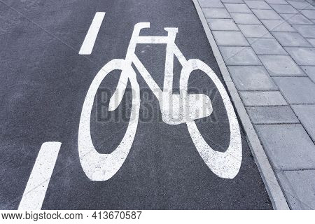 Bicycle Lane Background. Asphalt Road For Bikes. White Paint Bicycle Painted On Street. Pavement And