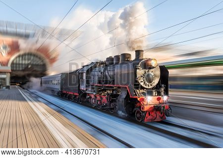 Locomotive Steam With Powerful Clouds Of Smoke Leaves The Station For A Retro Trip Motion Speed
