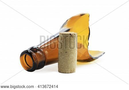 Wine Cork And Broken Wine Bottle Isolated On White Background As Symbol Of Alcoholism And Consequenc
