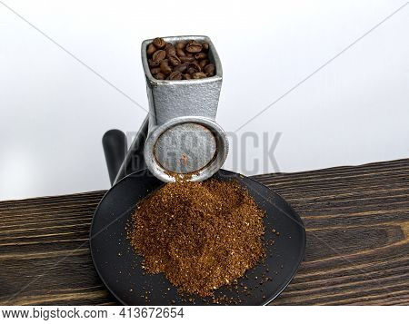 Vintage Antique Manual Coffee Grinder With Roasted Coffee Beans, Ground Coffee On Wooden Table