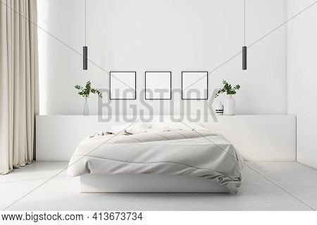 Modern Cozy Bedroom With White Linen And A White Wall With Three Blank Posters In The Background, Co