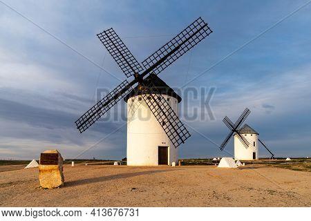 A View Of The Historic White Windmills Of La Mancha Above The Town Of Campo De Criptana In Warm Even