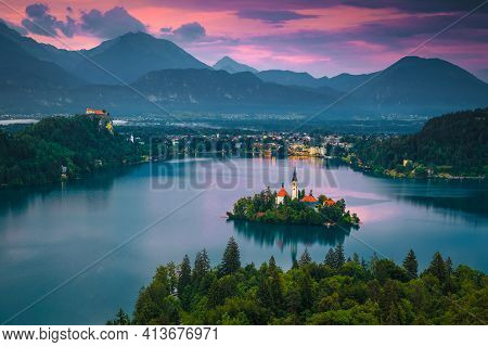Stunning Evening View With Lake And Church On The Small Island. Famous Travel And Touristic Location