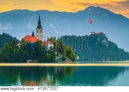 Amazing Alpine Destination With Colorful Hot Air Ballon Over The Bled Castle And Lake At Dawn, Bled,