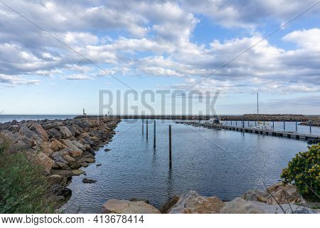 Rock Jetties And Mooring Docks In The Harbor At Port Barcares In France