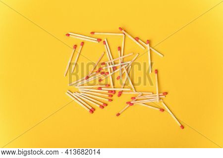 Red Matches On The Yellow Background, Top View.