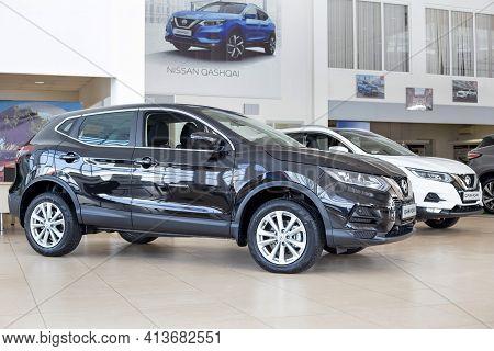 Russia, Izhevsk - February 19, 2021: Nissan Showroom. New Modern Cars Qashqai In Dealer Showroom. Fa