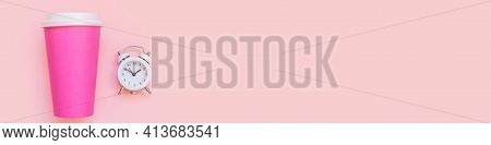 Simply Flat Lay Design Pink Paper Coffee Cup And Alarm Clock Isolated On Pink Pastel Background. Tak