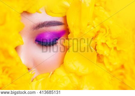 Fashion Eye With Flower, Asian Female Closeup Colorful Eyeshadow With Extreme Long False Eyelashes.