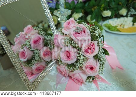 Pink Ribbon .pink Engagement Flowers On White Table . The Mirror Of The Pink Rose Is Mirror . The Op