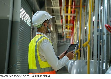Electrical Engineer Checking And Maintenance Equipment Condenser Water Pump In Electrical Energy Dis