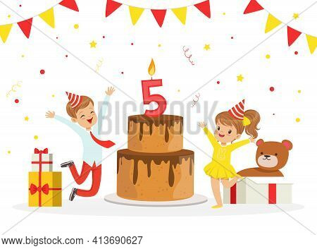 Excited Boy And Girl In Birthday Hat Jumping With Joy Near Huge Cake With Burning Number Candle Cele