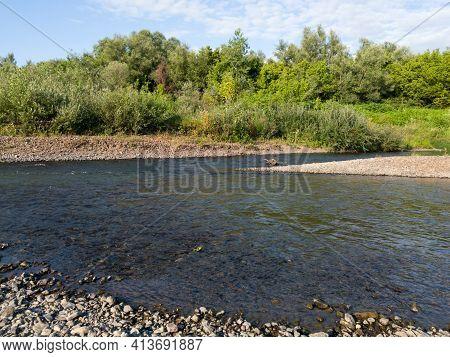 Fast Water Stream Erodes Gravel Shore, Gravel Deposit Environment On River