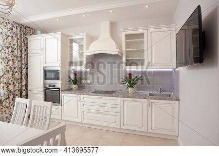 Photo Of Empty Minimalistic Interior Background, Kitchen In Modern Apartment With Counter, Curtain,