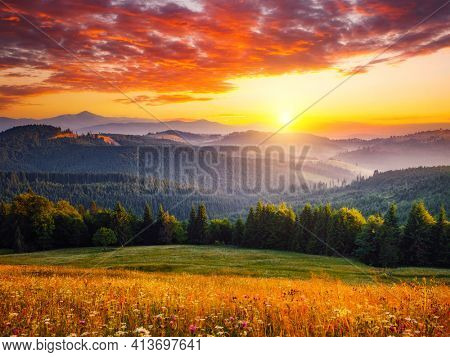 Spectacular sunset in the valley of the mountains. Location place Carpathian mountains, Ukraine, Europe. Vibrant photo wallpaper. Picturesque nature photography. Discover the beauty of earth.