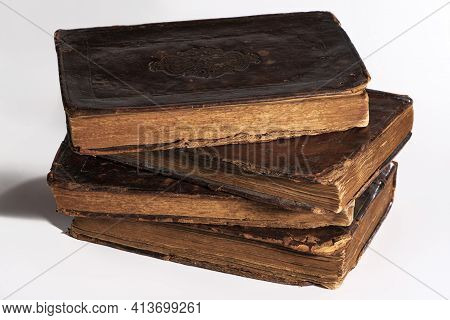 Old Worn Out Leather-bound Book Isolated On White Background. Stack. Closeup