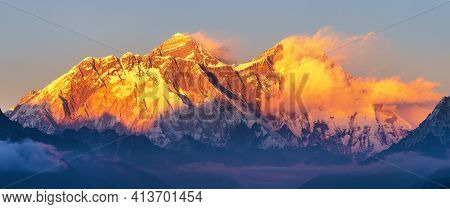 Mount Everest And Lhotse With Beautiful Clouds From Kongde Village, Evening Sunset Red Colored View,
