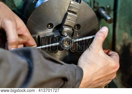 A Turner Cuts A Thread With A Lathe On A Lathe.