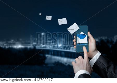 Email Marketing Business Concept. Businessman Sends Emails By Phone.