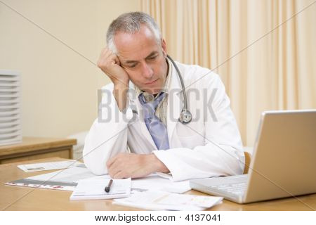 Doctor With Laptop In Doctor'S Office