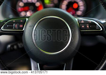 Modern Luxury Car Interior - Steering Wheel And Blurred Dashboard. Car Interior Luxury. Steering Whe