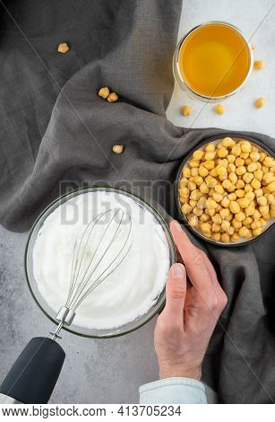 Chickpea Aquafaba. Egg Replacement. Vegan Cooking Concept. Men Hands Whippe Whisk Chickpeas Liquid I