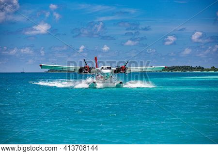 Trans Maldivian Airways Twin Otter Seaplanes At Male Airport. Exotic Scene With Trans Maldivian Airw