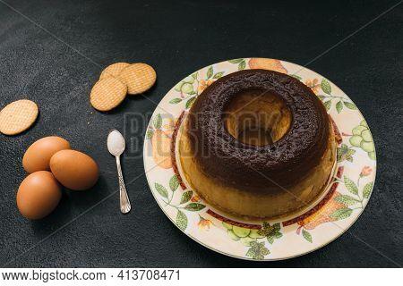 Egg Custard, Vanilla And Homemade Cookies On Dark Background