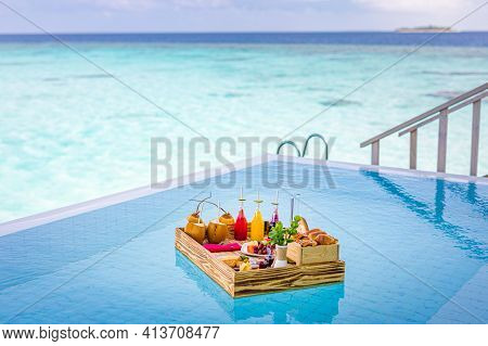 Breakfast In Swimming Pool, Floating Breakfast In Luxurious Tropical Hotel Resort. Table Relaxing On