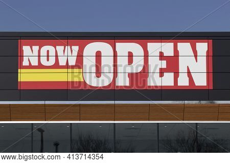 Now Open Sign Above A New Neighborhood Business.