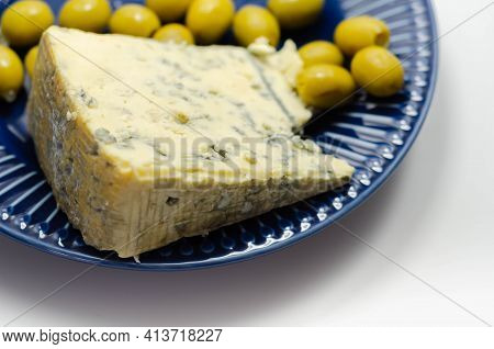 Full Fat Soft Blue Veined Cheese And Pickled Olives Stuffed Garlic On The Blue Plate