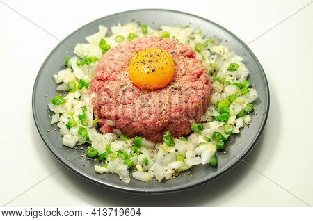 Beef Steak Tartare With Raw Egg Yolk And Onion With Chive