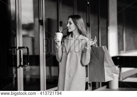 Happy Woman With Shopping Bags Enjoying Shopping. Consumerism, Lifestyle Concept