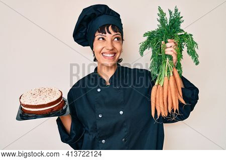 Beautiful brunettte woman chef cooking carrot cake smiling looking to the side and staring away thinking.