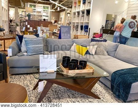 A Sectional Couch And Tables  At A West Elm Midcentury Modern Furniture Store In Orlando, Florida.