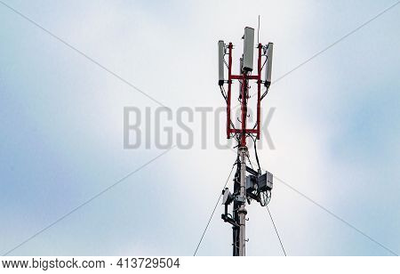 Technology On The Top Of The Telecommunication Gsm 5g, 4g, 3g Tower.cellular Phone Antennas On A Bui