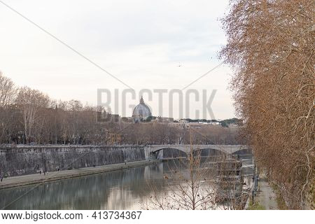 Rome. Italy. Spring 2020. Spring Roman Embankments. People Walk Along The Embankment. The Branches O