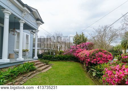 New Orleans, La - March 15: Victorian 1890s Home And Front Yard With Lawn And Blooming Azaleas In Up